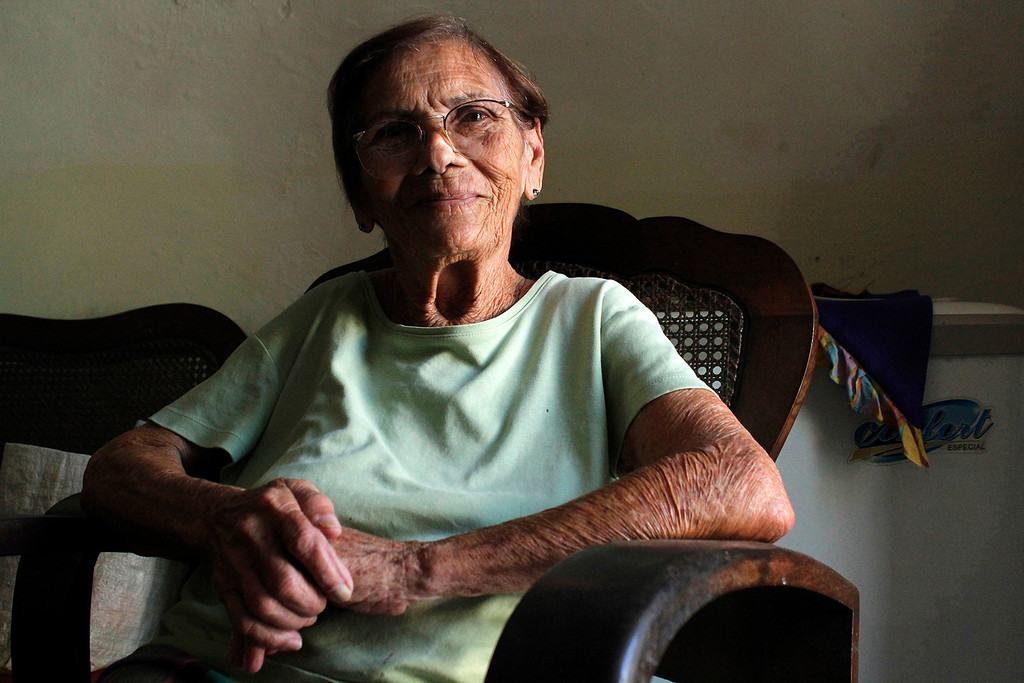 Melinda sits in her living room in Cardenas, Cuba on March 30, 2013. Photo by Stacey Rupolo / BU News Service.