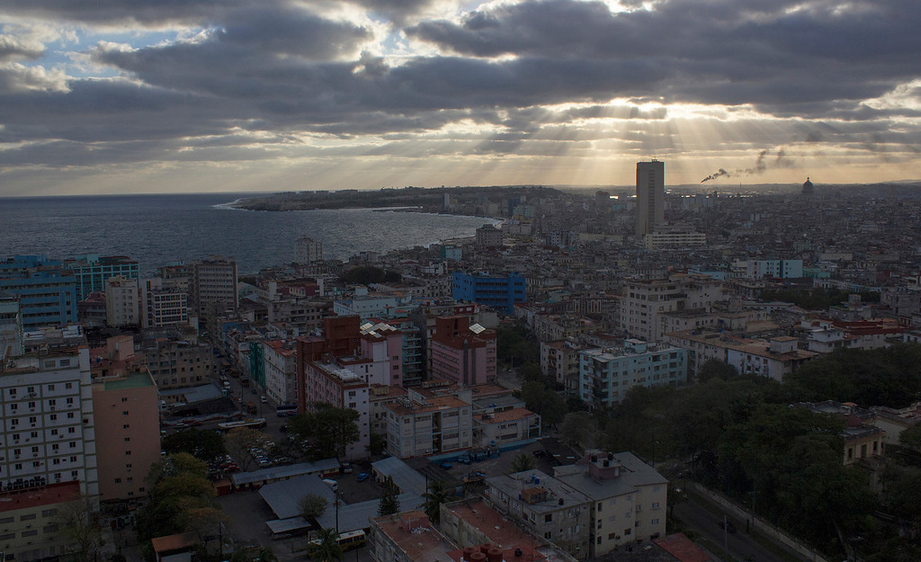 A beam of light shines over central Havana, Cuba on March 27, 2013. Photo by Stacey Rupolo /BU News Service.