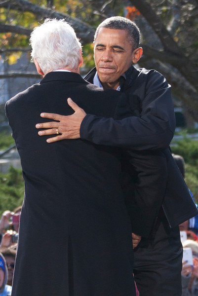 November 4, 2012 Concord, NH. Presdient Barack Obama embraces former Presdient Bill Clinton as he enters the stage at this past Sundays reelection rally in the swing state of NH.   Photo by Katherine Taylor