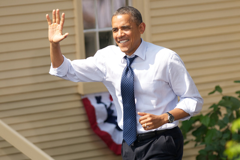 Portsmouth, NH, September 7, 2012:  President Barack Obama waves as he takes the stage at a campaign rally at the Strawbery Banke Museum the day after the conclusion of the Democratic National Convention.  The president appeared with First Lady Michelle Obama, Vice President Joe Biden and his wife Dr. Jill Biden.  According to the Obama campaign, over 6000 people attended the rally.