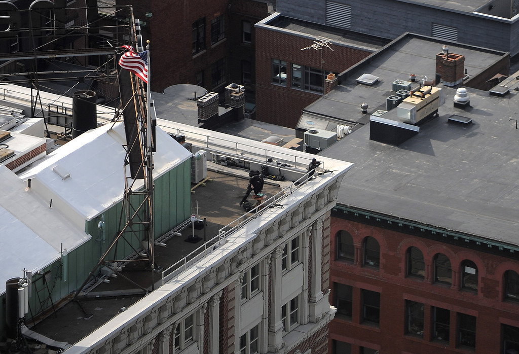 Boston, MA, April 15, 2013: Two explosions went off in Copley Square, directly after the finish line of the Boston Marathon. Snipers on the roof of a nearby hotel. Photo by: Michael Cummo
