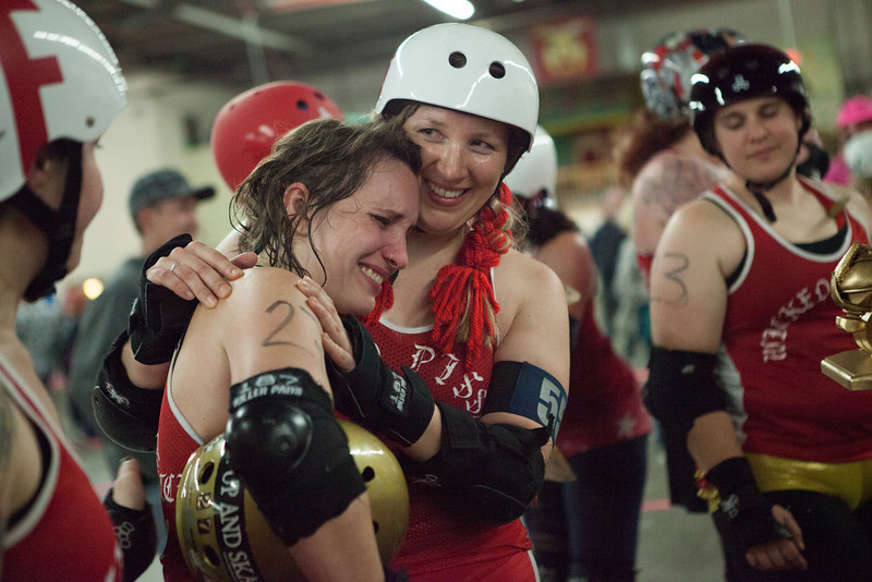 October 13, 2012.   Bad Person/Amy Chilton embraces Ivana Shankabitch/Sarah Marroy who is crying after winning this past Saturdays 2012 Golden Fez Championship match of roller derby at the Shriners Auditorium in Wilmington, MA.  The Wicked Pissahs won 169 to 131.  Photo by Katherine Taylor