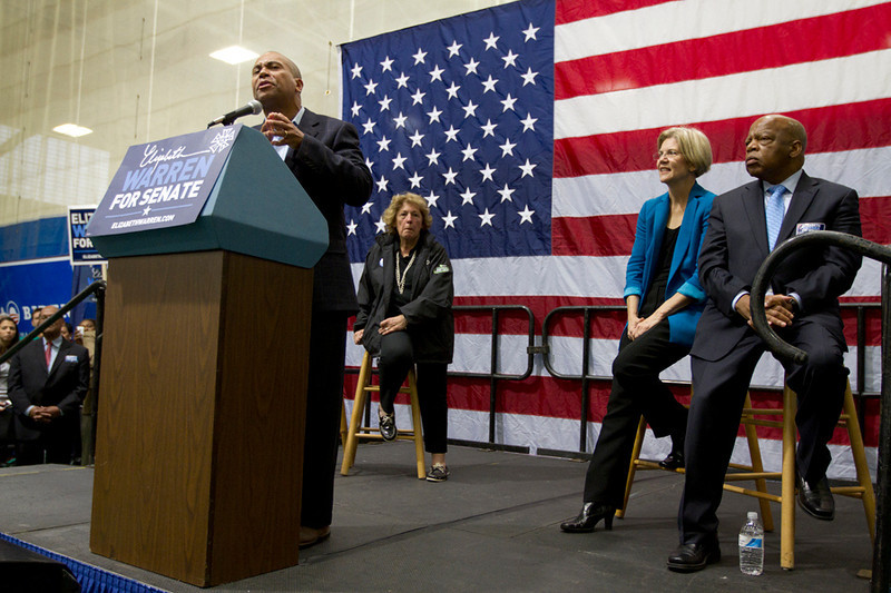 Democratic candidate for U.S. Senate Elizabeth Warren with U.S. Rep. John Lewis, D-Ga., center, and Massachusetts Gov. Deval Patrick, left, after speaking during a campaign rally at the Reggie Lewis Center in Boston, Saturday, Nov. 3, 2012.  © Hyunah Jang