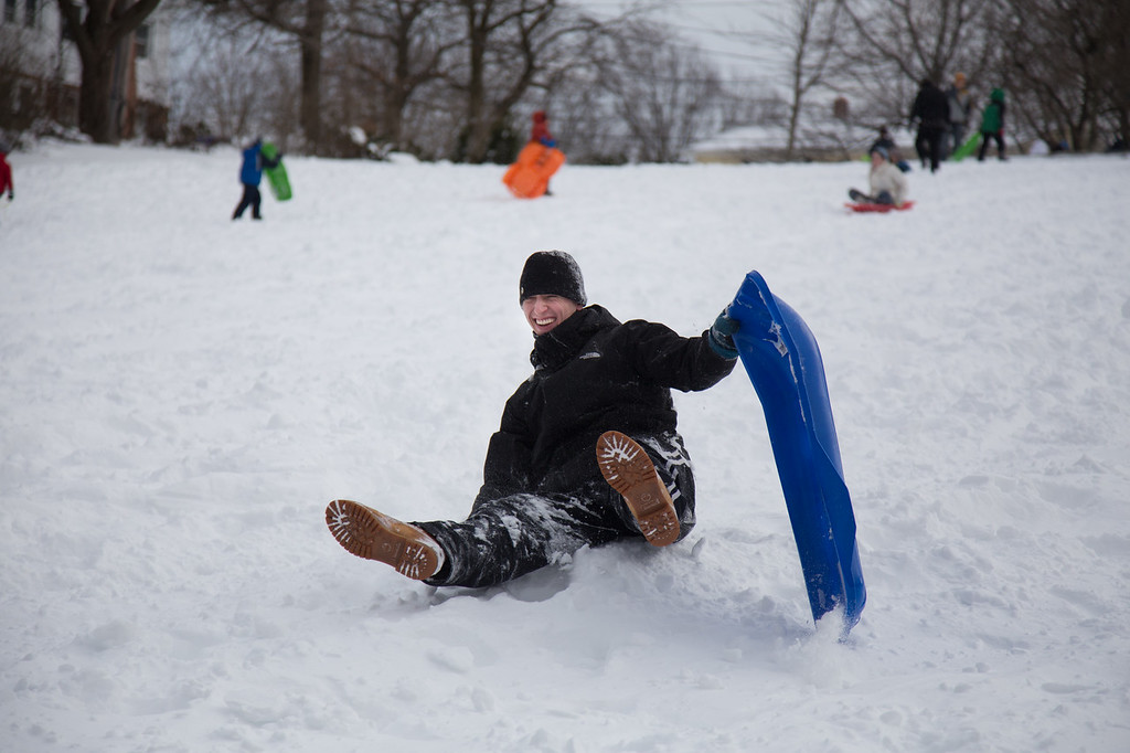 February 9, 2013 - Jonah Lundberg of Allston, MA topples off of his sled on Corey Hill in Brighton, MA on Saturday afternoon. Winter storm Nemo had dropped over 20 inches of snow on the area the night before. Photo by Alexa Gonzalez Wagner.