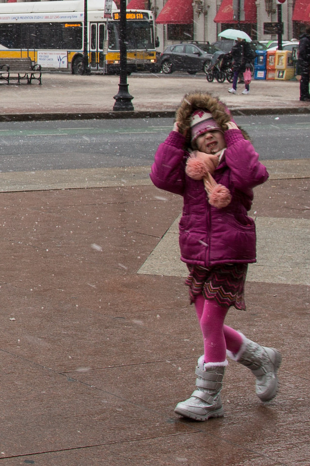 February 8, 2013 - A girl braces against the wind as snow begins to fall in Copley Square on Friday afternoon. The blizzard was just beginning in Boston. Photo by Alexa Gonzalez Wagner.