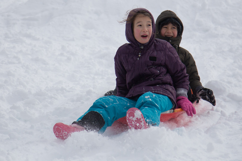 February 9, 2013 - Children sled down Corey Hill in Brighton, MA on Saturday afternoon. Winter storm Nemo had dropped over 20 inches of snow on the area the night before. Photo by Alexa Gonzalez Wagner.