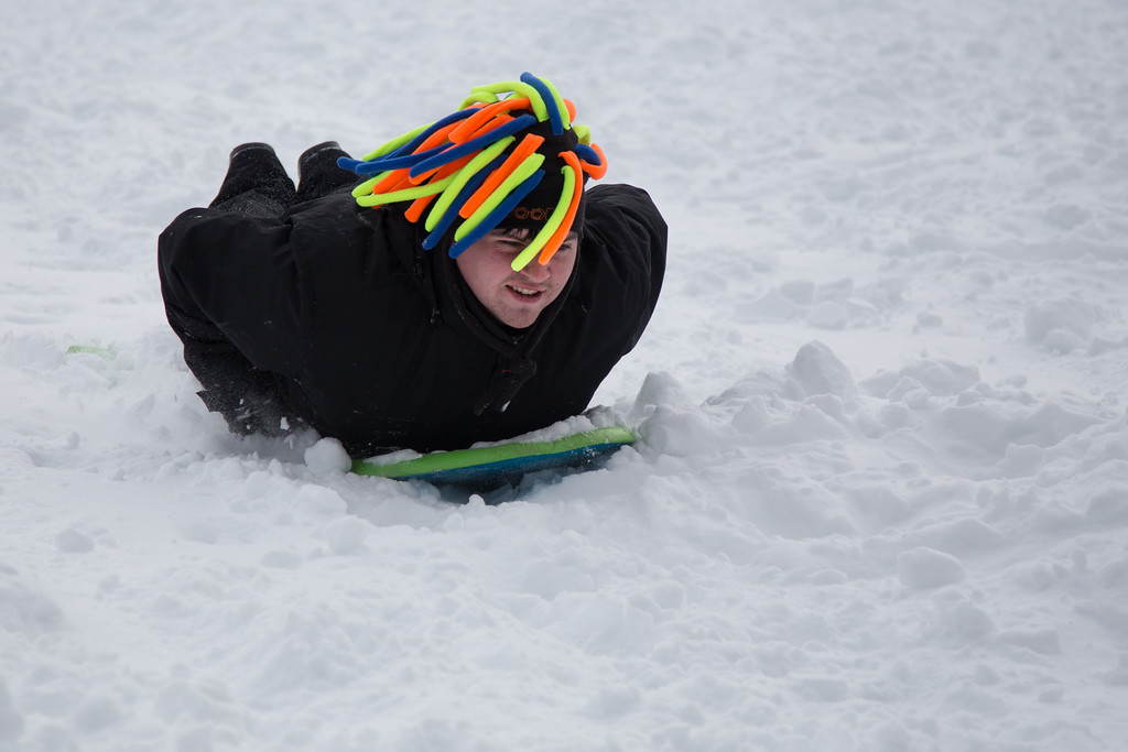 February 9, 2013 - A man sleds down Corey Hill in Brighton, MA on Saturday afternoon. Winter storm Nemo had dropped over 20 inches of snow on the area the night before. Photo by Alexa Gonzalez Wagner.