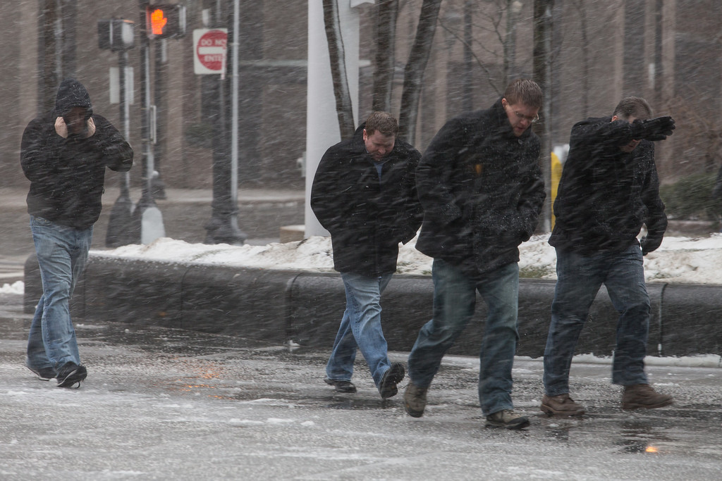 Febrary 8, 2013 - Men braces themselves against the wind and snow as the blizzard began to hit downtown Boston on Friday afternoon. Photo by Alexa Gonzalez Wagner.