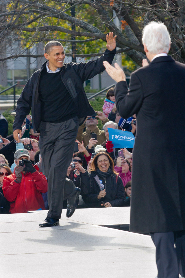 """Nov. 4 - President Barak Obama waves to the crowd as he takes the stage Sunday at his Concord, N.H. rally. Former President Bill Clinton (right) spoke before the president-elect, """"firing up"""" the 14,000 in attendance. (Photo by Micaela Bedell)"""
