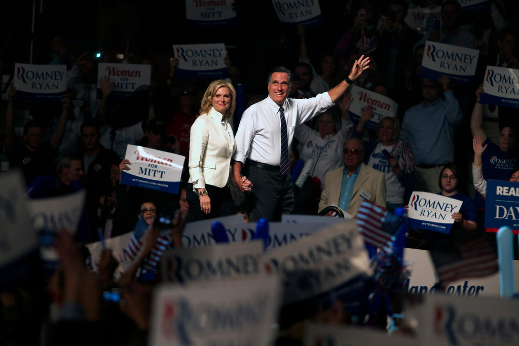 """NOV 5, 2012 – Governor Mitt Romney, with his wife Ann, are welcomed by the crowd prior to his speech at the final campaign stop in his bid to become President in Manchester, New Hampshire at the Verizon Wireless Arena. Romney has been warmly received in the state, winning the Republican nomination in January with 39.3%. """"This moment is special for me and Ann, because this is where our campaign began,"""" Romney said. (Photo by Michael Cummo)"""