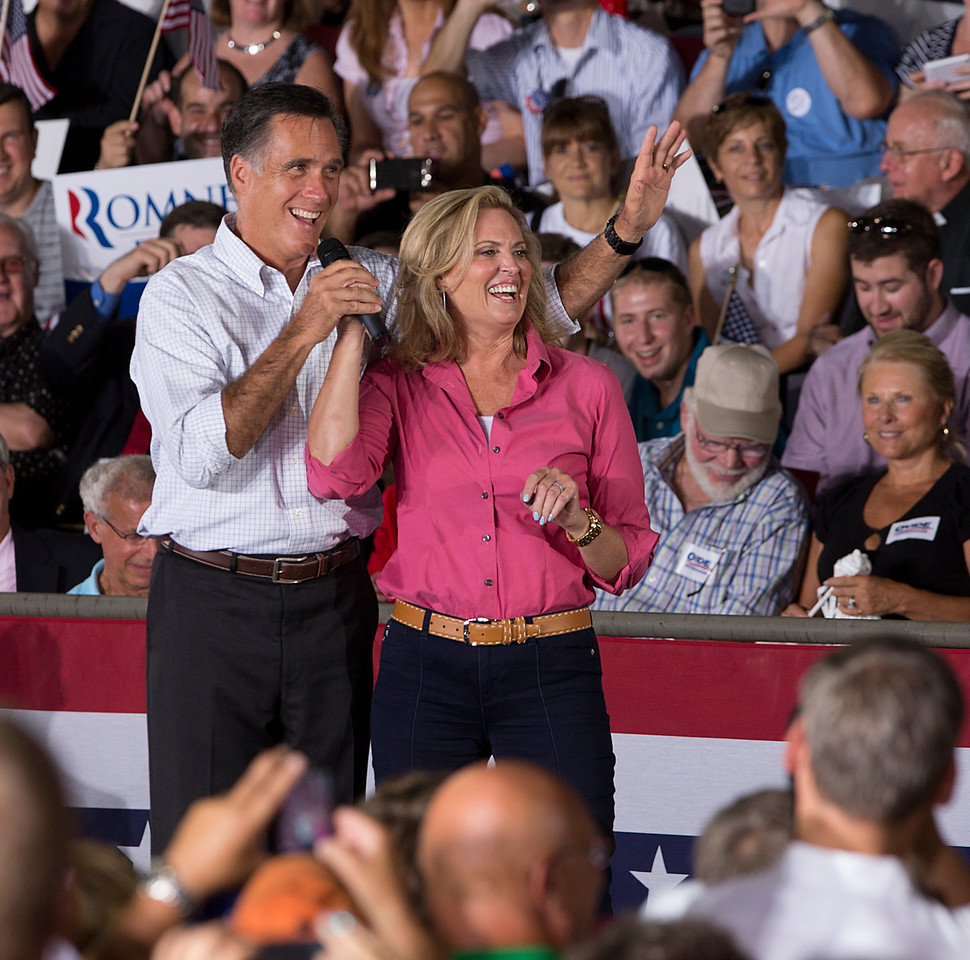 """Sept. 7, 2012 - Republican presidential candidate Mitt Romney and wife Ann Romney laugh after a supporter yelled """"I love you!"""" to Mrs. Romney during a rally in Nashua, New Hampshire. Photo by Sarah Ganzhorn."""
