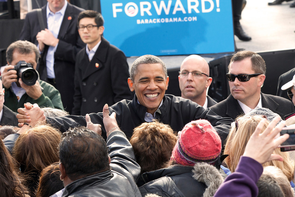 """November 4, 2012 Concord, NH.  President Barack Obama reaches out to shake the hands of supporters at a rally in Concord NH Sunday.  Obama repeated one of his campaign themes several times: """"Let's not stop what we have started in this country."""" Photo by Katherine Taylor, BU News Service"""