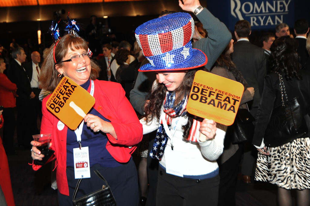 Nov. 6, 2012 - Helen Marrone (left) and daughter, Julianna, of Carver, Mass. dance and show their support for Mitt Romney on the ballroom floor in the Boston Convention Center, the site of the Romney-Ryan election night headquarters. Photo by Billie Weiss.