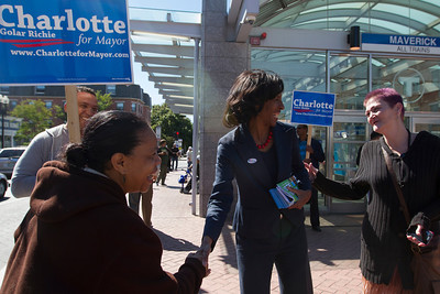 September 24, 2013. Boston mayoral candidate Charlotte Golar Richie greets followers of her campaign at Maverick Square, East Boston. Photo by Dominique Riofrio.