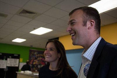 Sept. 24, 2013 -- Boston City Councillor candidate Michael Nichols, right, and his girlfriend, Amy Cowen, left, speak with a poll worker, not pictured here, at Fenway High School in Boston, MA. Nichols is running for Boston City Council's Eighth District seat. Photograph by Carolyn Bick.
