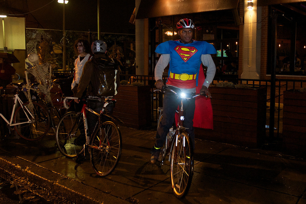 October 31, 2013. Hari Arisetty (right) gets ready to leave the Canary Square Bar in Jamaica Plain where various cyclist arrived after a 16 miles halloween bike ride around Boston. There were two starting points, one in Jamaica Plain and the other in South Station. Cyclist wearing costumes rode their bikes around Cambridge, Allston, Brookline and back to Jamaica Plain. Photo by Dominique Riofrio.