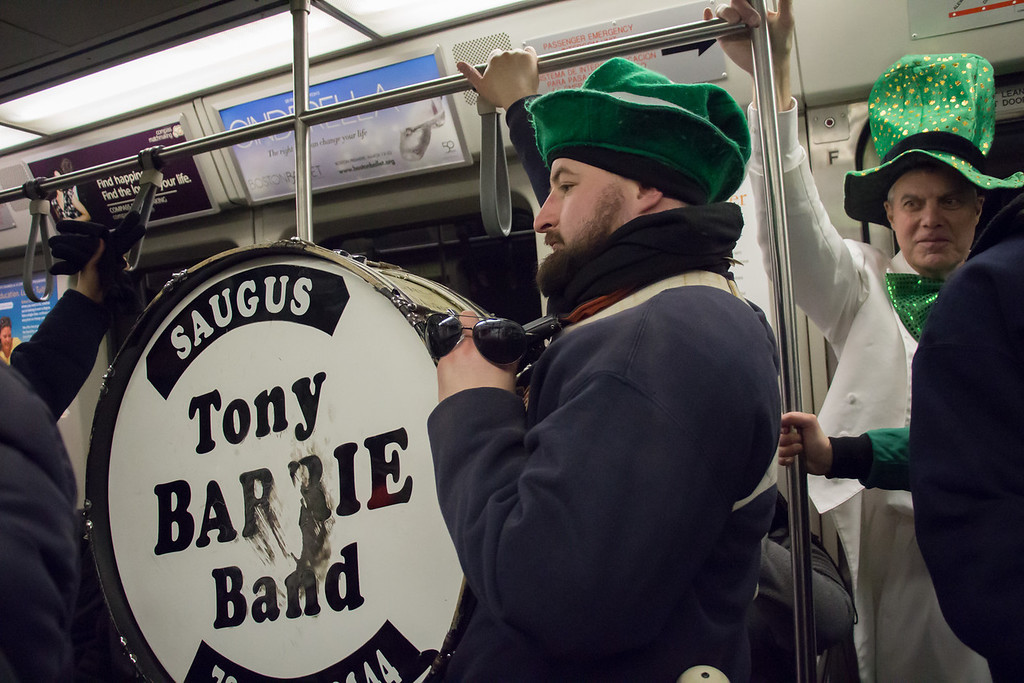 Boston, March 16, 2014 -- Performer Harrison Swyter rides the T after finishing the St. Patrick's Day parade route at Andrew Station in South Boston. Photograph by Carolyn Bick. © Carolyn Bick/BU News Service 2014.