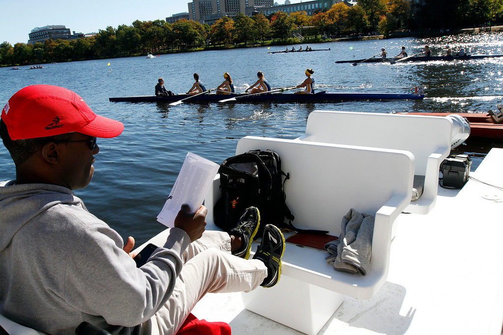 Boston University Women's Lightweight Coach, Malcolm Doldron looks at the roster of high schools rowing by him in the Head of the Charles Regatta while timing his main potential recruits' stroke times on Oct. 20, 2013 at BU's Dewolfe Boathouse in Boston, Mass. The new women's lightweight program at BU will make its' first appearance at the Head of the Charles today. Photo by Grace Donnelly.
