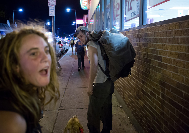 "Sep. 20, 2013 - Two 20-year-old homeless people who asked to be identified as Toby (left) and Anchor (right) depart the location where they had been asking pedestrians for money and alcohol outside Blanchard's liquor store in Allston after police asked them to leave. ""I ran away at 13,"" Anchor said. ""Probably because my mom wanted me to do dishes."""