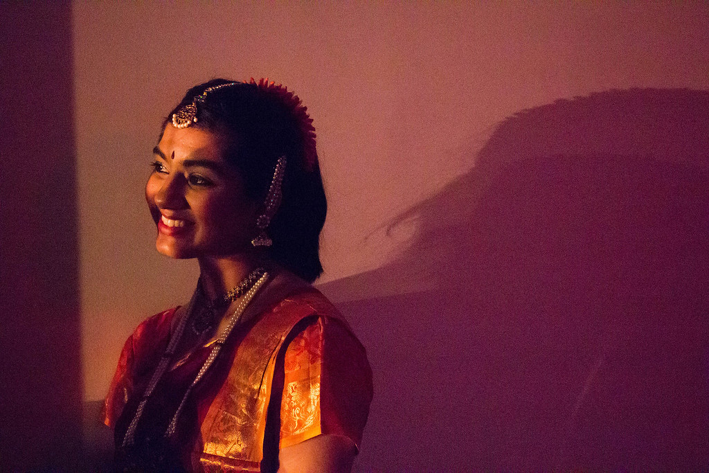 Boston, Nov. 10, 2013 -- Solo dancer and Boston University junior Ramya Rajpurohit, left, smiles  backstage at dancers exiting the stage during BU Dheem's Indian dance presentation entitled, 'Mahila', in Boston University's FitRec dance theatre in Boston, MA. Dheem dancer and BU senior Aisha Rawji, not pictured here, said the Indian word 'mahila' means 'women', and that the team chose the title to honor the women in the participating dancers' lives. Dancers from BU, Harvard, and MIT participated in the show. Photograph by Carolyn Bick.
