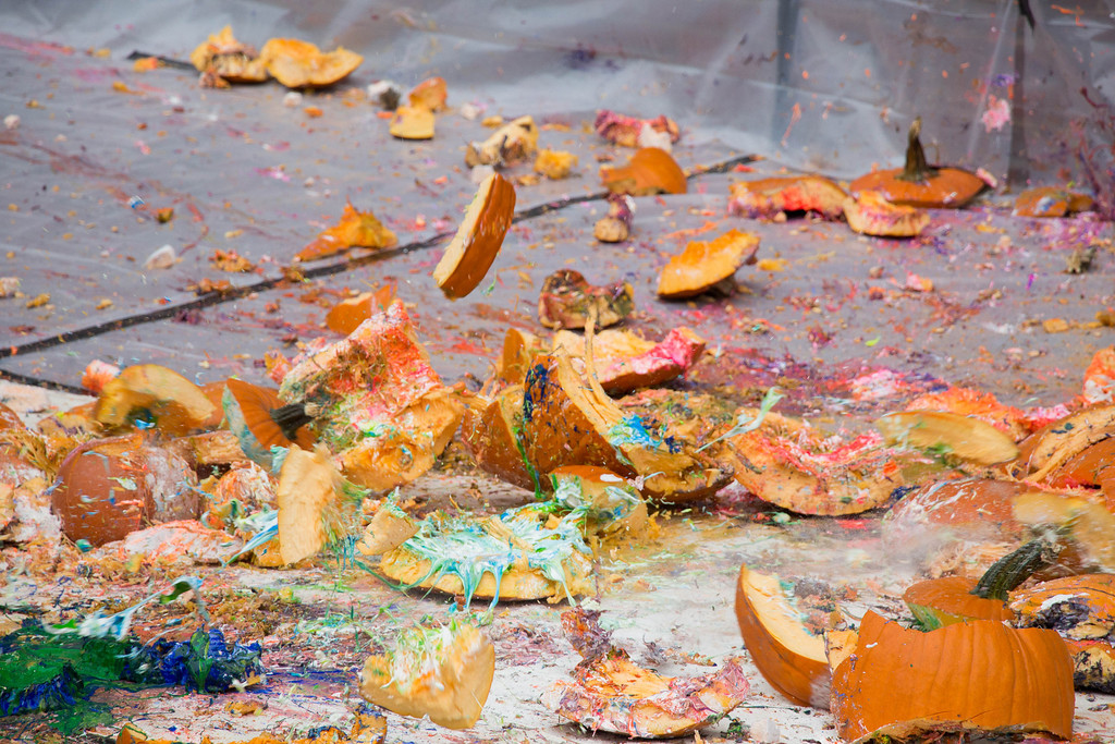 "Boston, Oct. 31, 2013 -- Pumpkins smash to the ground during the Boston University Physics Department's 9th annual Pumpkin Drop. The Boston University Physics Department holds the Pumpkin Drop on or around Halloween, in which members of the Physics Department push pumpkins filled with paint and whipped cream off the top of the Metcalf Science Center to show that ""gravity still rules"". Photograph by Carolyn Bick."