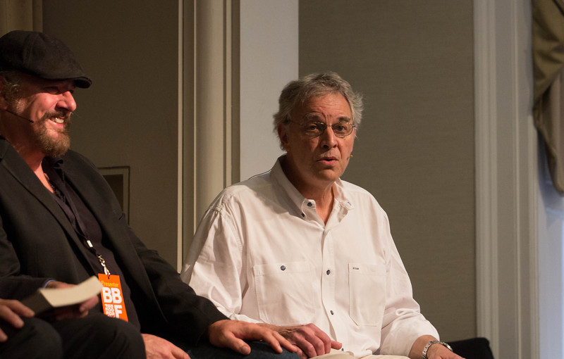 Bill Littlefield jokes while Glenn Stout laughs