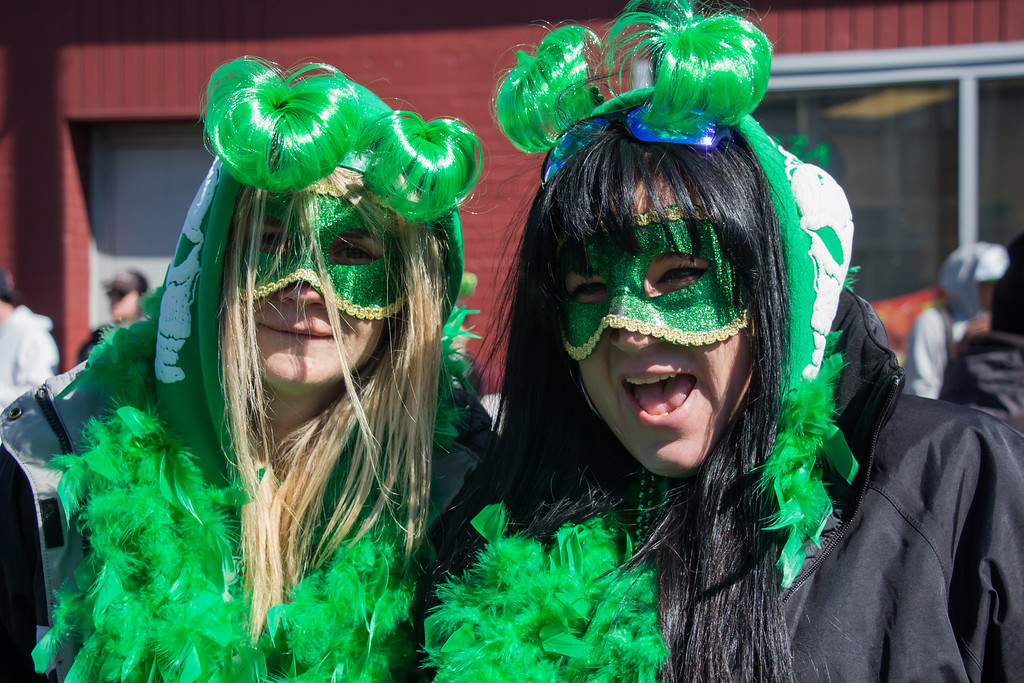 Boston, March 16, 2014 -- Danielle Guillette, right, and Karen Nardone, left, celebrate  near Andrew Station at the St. Patrick's Day parade in South Boston. Photograph by Carolyn Bick. © Carolyn Bick/BU News Service 2014.