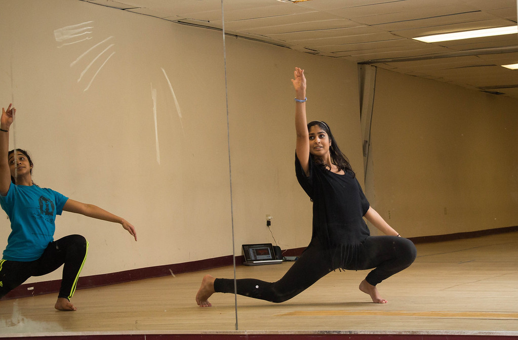 "Boston, Nov. 9, 2013 -- Boston University Dheem dancers Aisha Rawji, BU senior, right, and Samantha Venkatesh, BU sophomore, left, practice last-minute choreography in Boston University's George Sherman Union in Boston, MA, to the song 'Tamally Maak' in preparation for BU Dheem's Indian dance presentation entitled, 'Mahila', the following evening. ""This is my last performance,"" said Rawji. ""We were going to have a performance in the spring, too, but we have too many competitions coming up."" Rawji said the Indian word 'mahila' means 'women', and that the team chose the title to honor the women in the participating dancers' lives. Dancers from BU, Harvard, and MIT participated in the show. Photograph by Carolyn Bick."