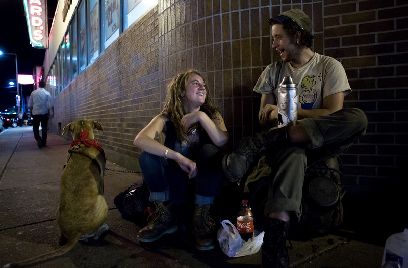 Sep. 20, 2013 - Two homeless 20-year-olds who asked to be identified as Toby (left) and Anchor (right) sit outside Blanchard's liquor store in Allston where they asked pedestrians for money and alcohol with their dog, Venus. The couple had recently traveled from Colorado by hitching rides on cargo trains.