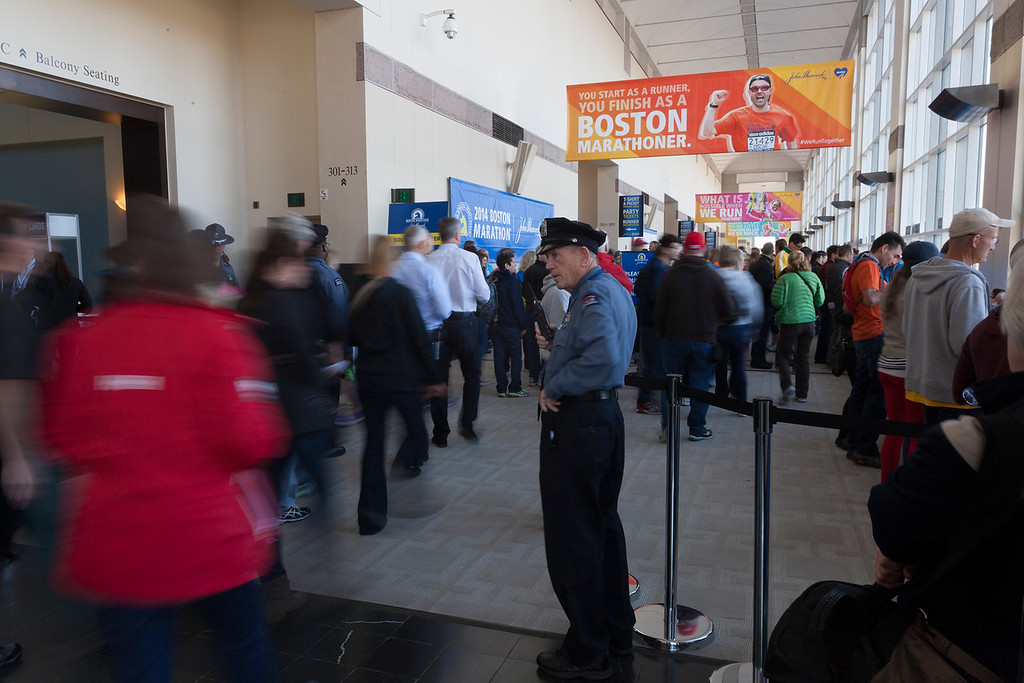 April 19, 2014. Runners pick up their number for the marathon at the Hynes Convention Center in Boston, Mass. Photo by Dominique Riofrio.