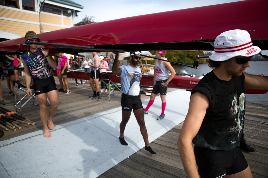 Oct. 19, 2013 - Members of the Boston University crew team carry their boat before placing it in the water at the Head of the Charles regatta, an annual series of rowing contests on the Charles river in Boston, Mass.