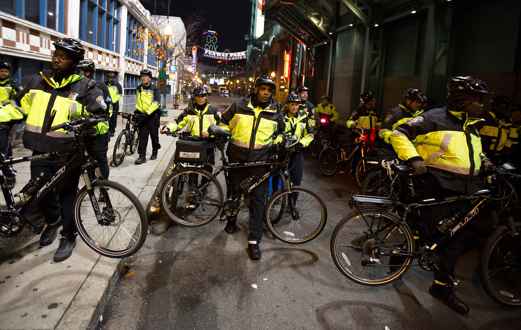 Oct. 30, 2013 - Boston Police officers use bicycles to push back crowds that gathered for the potential celebration that could follow a Red Sox World Series win at Fenway Park in Boston. Photo by Justin Saglio.
