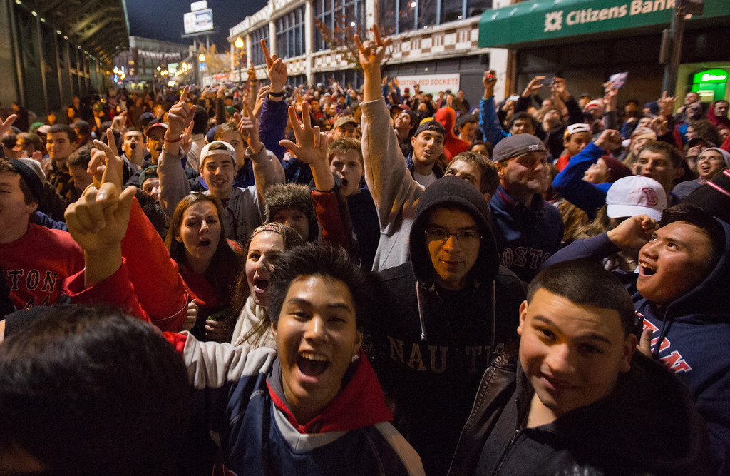 Oct. 30, 2013 - Red Sox fans celebrate at Fenway Park in Boston after the home team takes a 3-0 lead in a game that would secure the team a World Series victory. Photo by Justin Saglio.