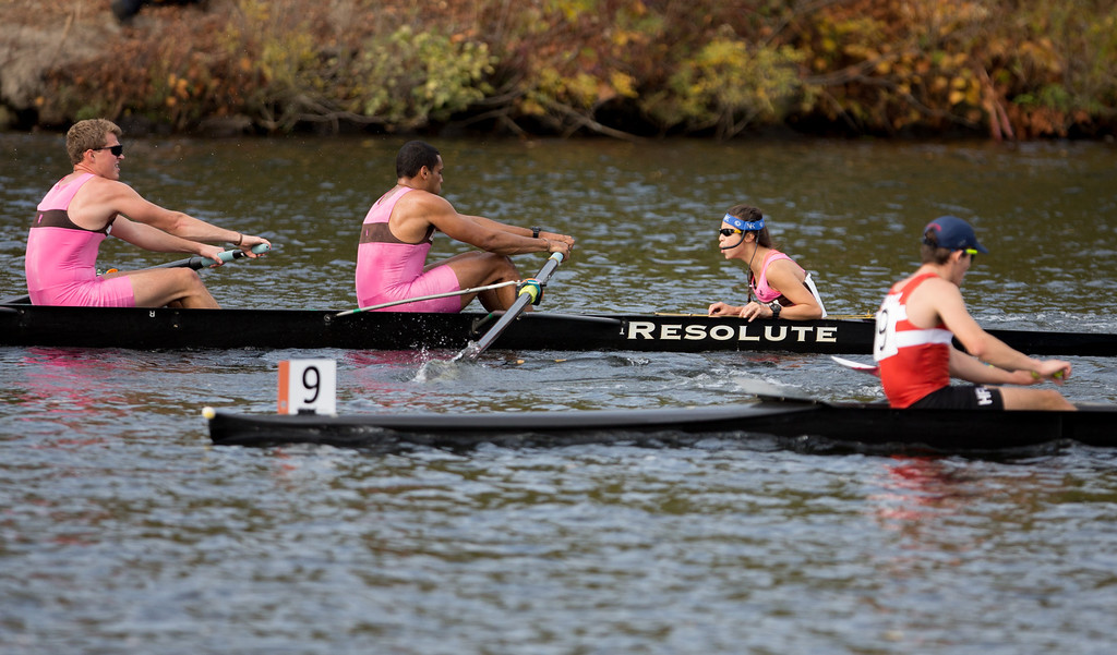 Oct. 19, 2013 - A team's coxswain, who works to direct the boat and motivate paddlers, yells encouragement to team members near the finish line of a race at the Head of the Charles regatta, an annual series of rowing contests on the Charles river in Boston, Mass.