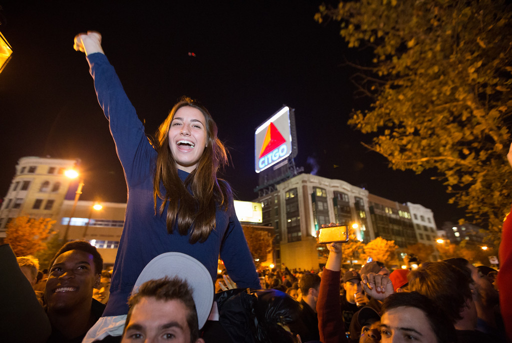 Oct. 30, 2013 - Students in the Kenmore Square area of Boston celebrate after learning the Red Sox had won the World Series with a victory at Fenway Park in Boston. Photo by Justin Saglio.