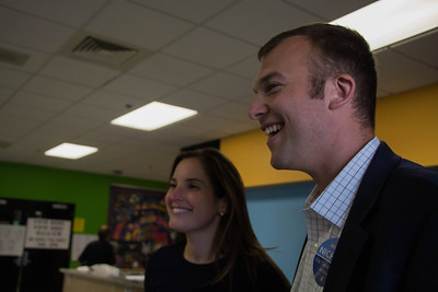 Sept. 23, 2013 -- Boston City Councillor candidate Michael Nichols, right, and his girlfriend, Amy Cowen, left, speak with a poll worker, not pictured here, at Fenway High School in Boston, MA. Nichols is running for Boston City Council's Eighth District seat.