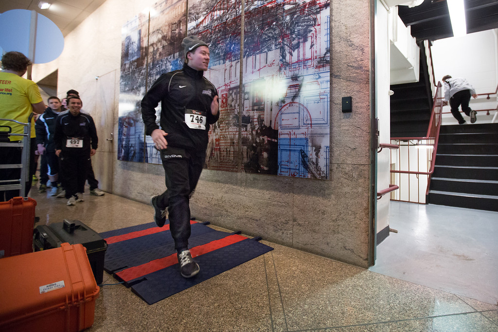 Jan. 26, 2014 -- Participants cross the starting line at ClimbAmerica!, a fundraiser at the 40-story Exchange Place building in Boston Mass. During the event, which raised $65,000 for heart disease prevention, participants raced up the building's staircase. Credit: Justin Saglio/BU News Service.
