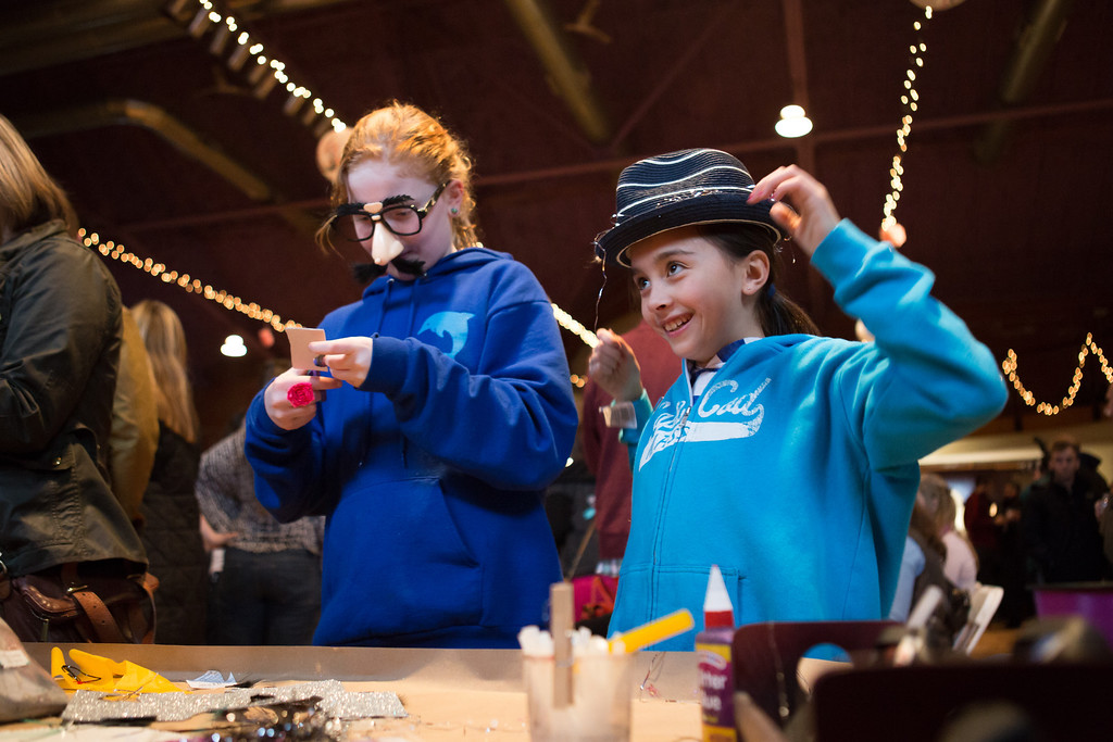 Feb. 2, 2014 - Alice Westad, 10, (left) and Zoe Miller, 9, decorate hats and create beards from yarn at at Beardfest, a facial hair competition in Sommerville, Mass. Credit: Justin Saglio