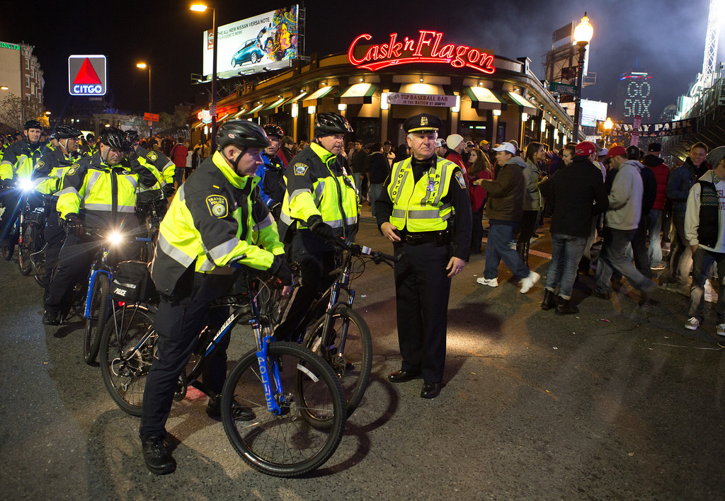 Oct. 30, 2013 - Boston Police officers prepare for the possible that could follow a Red Sox World Series win at Fenway Park in Boston. Photo by Justin Saglio.