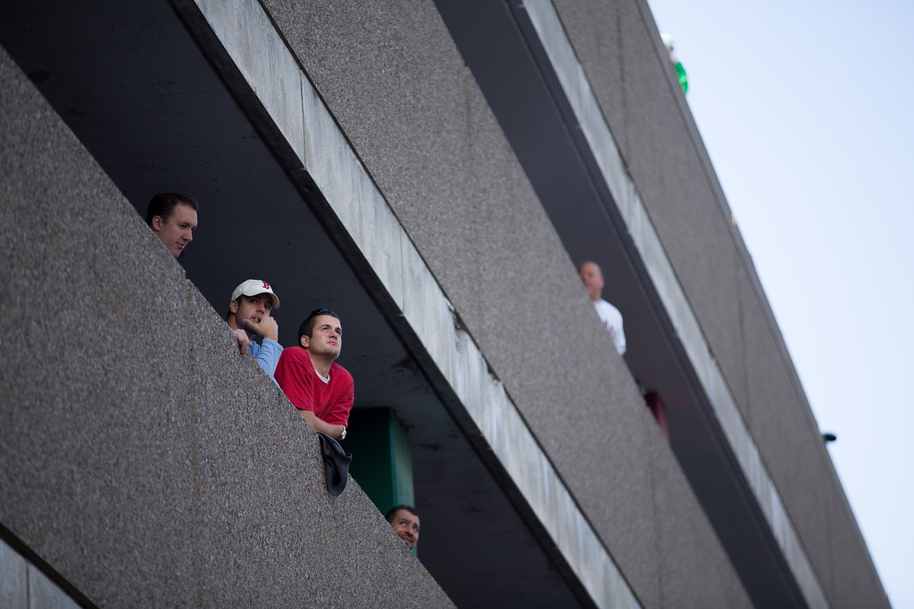 Nov. 2, 2013 - Spectators watch a Red Sox World Series Championship parade from a parking garage on Cambridge Street in Boston. Photo credit Justin Saglio/BU News Service.