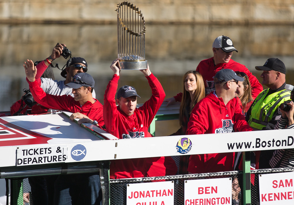Nov. 2, 2013 - A Red Sox player raises the championship trophy during a parade celebrating the team's victory in the 2013 World Series. Photo by Justin Saglio/BU News Serice.