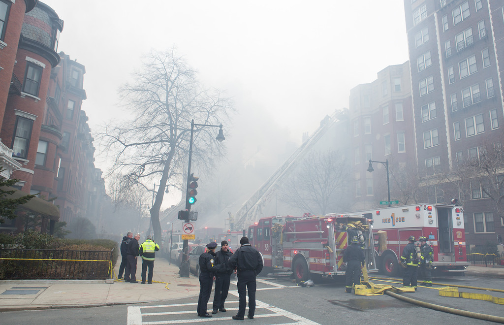 March 26, 2014 - Firefighters respond to a 9-alarm fire on Beacon Street in Boston, Mass.