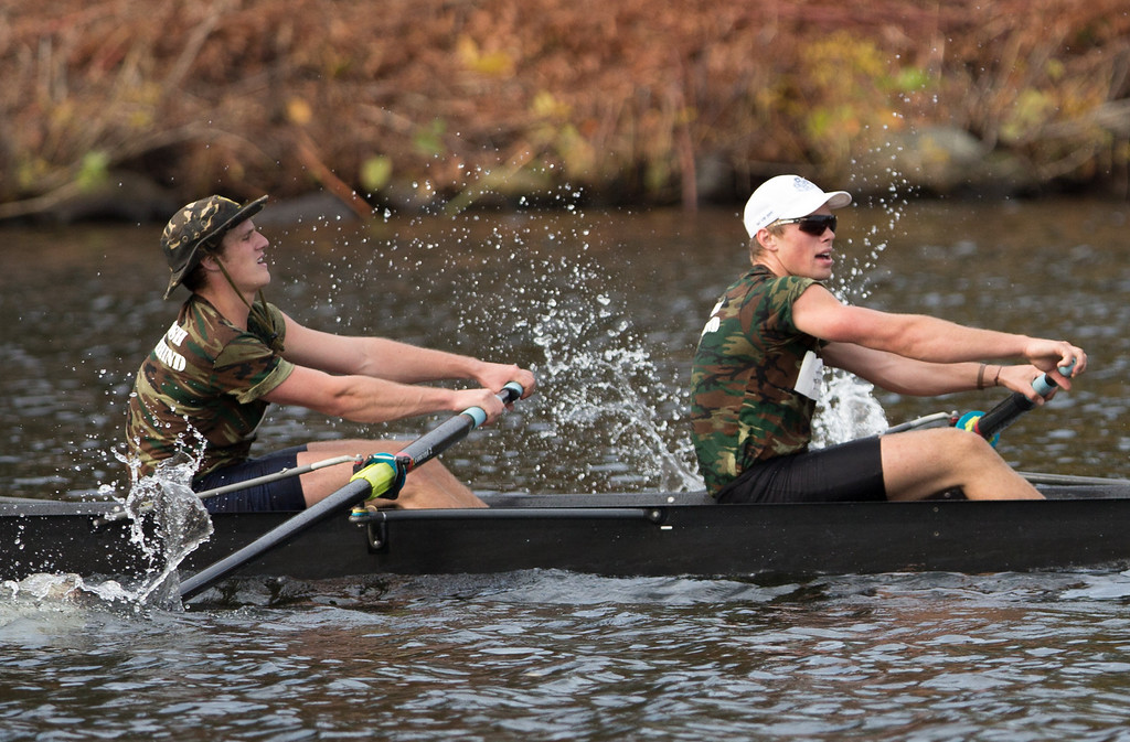 Oct. 19, 2013 - Exhausted rowers paddle toward the finish line at the Head of the Charles regatta, an annual series of rowing contests on the Charles river in Boston, Mass.