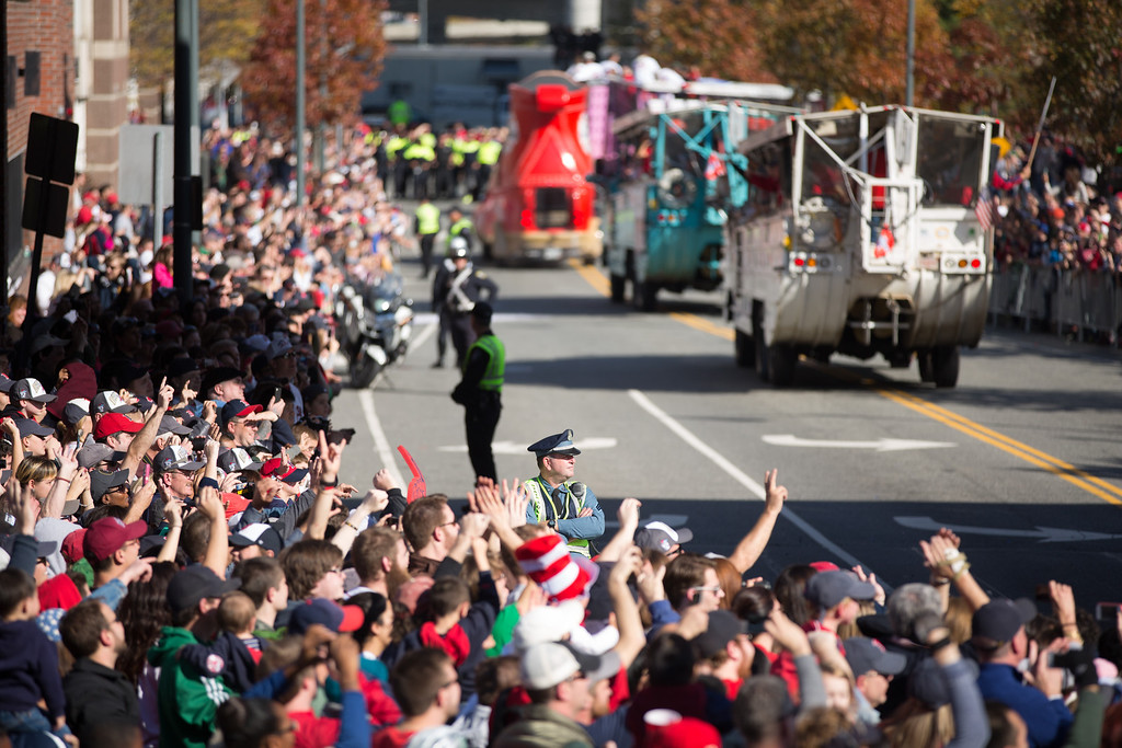 Nov. 2, 2013 - Police officers stand guard as duck boats carrying Red Sox players and staff pass by during a parade celebrating the team's victory in the World Series. Photo by Justin Saglio/BU News Serice.