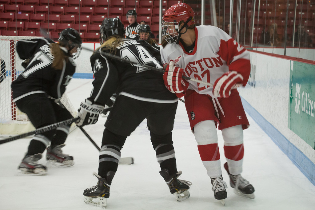 Boston, March 1, 2014 -- Boston University women's hockey forward Jordan Juron, center right, Providence College women's hockey defense Victoria Virtue, center left, and forward Brooke Simpson, left, play in the Women's Hockey East Quarterfinals. The game was held at Boston University's Walter Brown Arena in Boston, MA. BU won 3-2. Photograph by Carolyn Bick. © Carolyn Bick/BUNS 2014.
