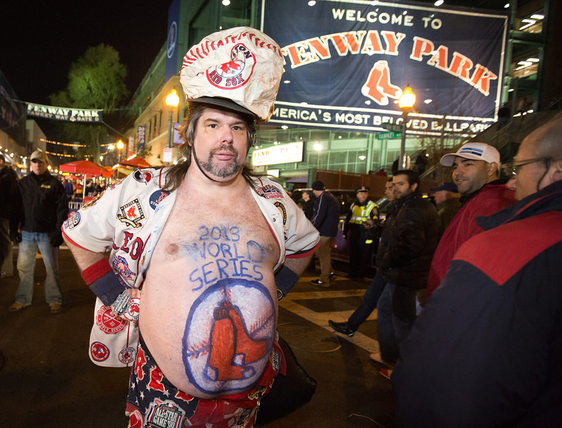 Oct. 23, 2013 - Mike Schuster shows off a painted belly at Fenway Park before game one of the World Series in Boston. Photo by Justin Saglio