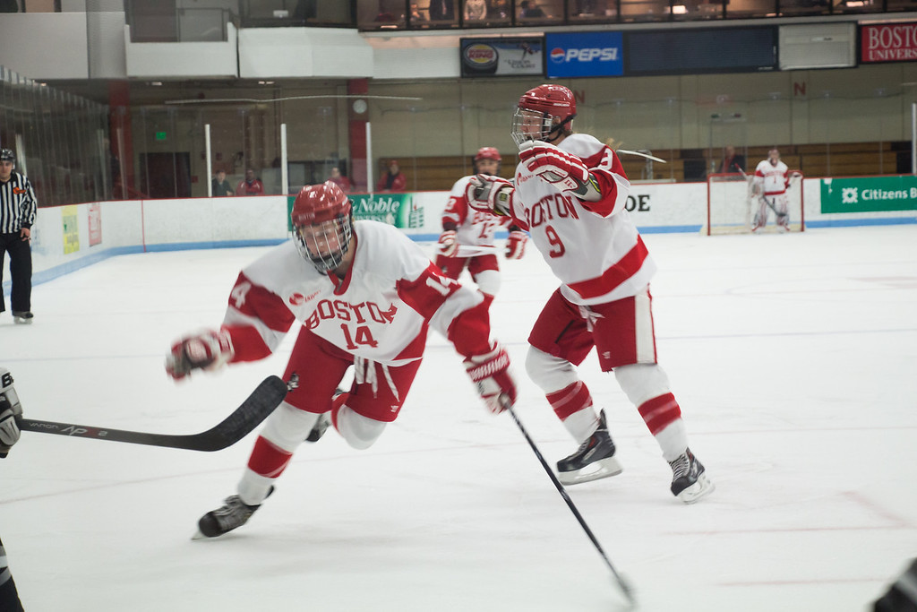 Boston, March 1, 2014 -- Boston University women's forwards Maddie Elia, center, and Sarah Lefort, right, play during the East Quarterfinals against Providence College. The game was held at Boston University's Walter Brown Arena in Boston, MA. BU won 3-2. Photograph by Carolyn Bick. © Carolyn Bick/BUNS 2014.