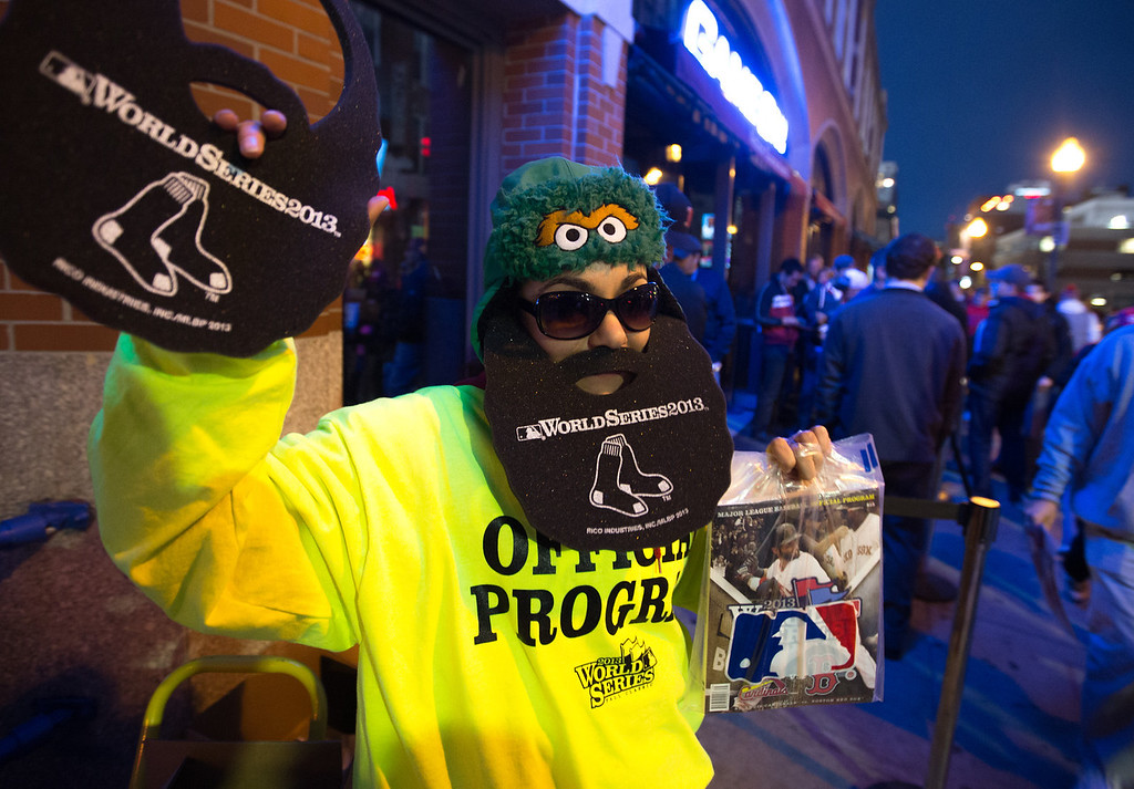 Oct. 23, 2013 - Shavon Rodruquez sells foam beards and programs outside Fenway Park before game one of the World Series in Boston.  Photo by Justin Saglio
