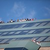 November, 2, 2013, BOSTON- People stand on the roof of a building near the Boston Marathon finish line, waiting for the Red Sox World Series victory parade. Photo by KIva Kuan Liu