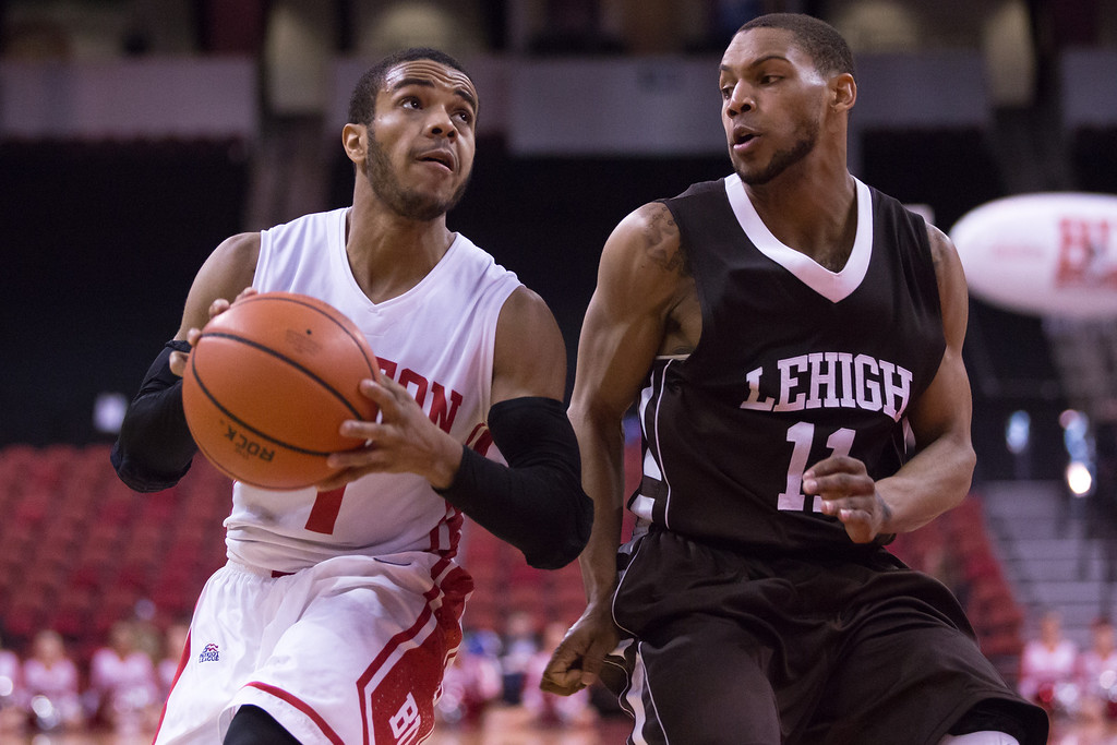 Feb. 1, 2014 - Boston University's Maurice Watson drives to the basket against Lehigh's Mackey McKnight in the second half at Aggannis Arena in Boston, Mass. Watson scored nine points and had seven assists. Photo credit: Justin Saglio/ BU News Service.